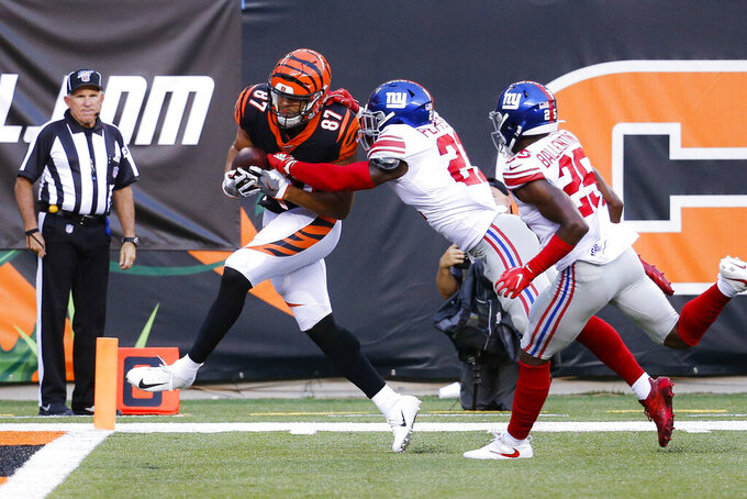 Cincinnati Bengals tight end C.J. Uzomah (87) nears the end zone on the way to a touchdown, as New York Giants safety Jabrill Peppers (21) defends during the first half of an NFL preseason football game Thursday, Aug. 22, 2019, in Cincinnati. (AP Photo/Frank Victores)