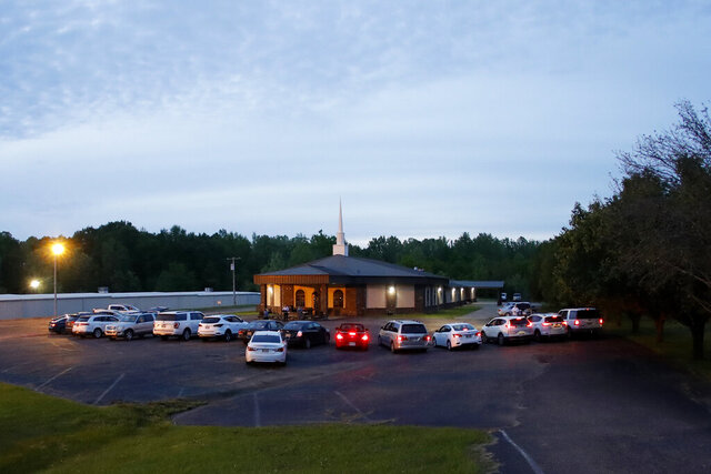 Congregants remain in their cars during a prayer service held outside at First United Pentecostal Church, Thursday, April 2, 2020, in Brandon, Miss. (AP Photo/Julio Cortez)