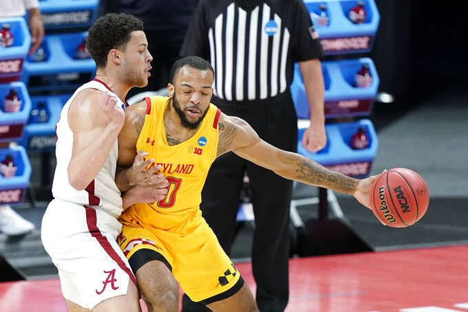 Maryland's Galin Smith, right, is defended by Alabama's Alex Reese during the first half of a college basketball game in the second round of the NCAA tournament at Bankers Life Fieldhouse in Indianapolis Monday, March 22, 2021. (AP Photo/Mark Humphrey)