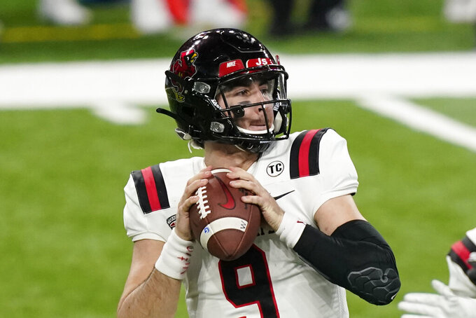 Ball State quarterback Drew Plitt looks downfield during the first half of the Mid-American Conference championship NCAA college football game against Buffalo, Friday, Dec. 18, 2020 in Detroit. (AP Photo/Carlos Osorio)