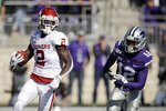 Oklahoma wide receiver CeeDee Lamb (2) gets past Kansas State defensive back AJ Parker (12) to run the ball during the first half of an NCAA college football game Saturday, Oct. 26, 2019, in Manhattan, Kan. (AP Photo/Charlie Riedel)