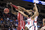Mississippi guard D.C. Davis (20) and Bruce Stevens, right, battle for a rebound against Oklahoma forward Kristian Doolittle, left, during a first round men's college basketball game in the NCAA Tournament Friday, March 22, 2019, in Columbia, S.C. (AP Photo/Sean Rayford)