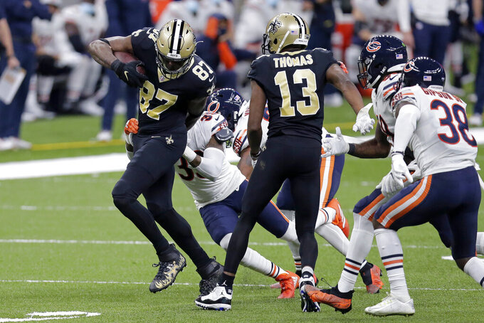 New Orleans Saints tight end Jared Cook (87) carries for a first down against Chicago Bears free safety Eddie Jackson in the second half of an NFL wild-card playoff football game in New Orleans, Sunday, Jan. 10, 2021. (AP Photo/Brett Duke)