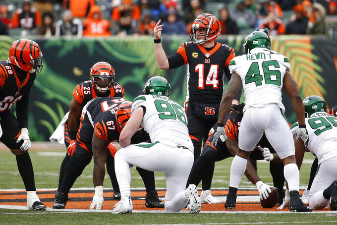 Cincinnati Bengals quarterback Andy Dalton (14) directs his players from the line of scrimmage during the second half of an NFL football game against the New York Jets, Sunday, Dec. 1, 2019, in Cincinnati. (AP Photo/Frank Victores)