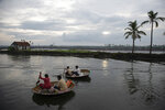 Fishermen row their traditional boats as they set out to fish in the morning in Kochi, Kerala state, India, Monday, June 1, 2020. (AP Photo/ R S Iyer)