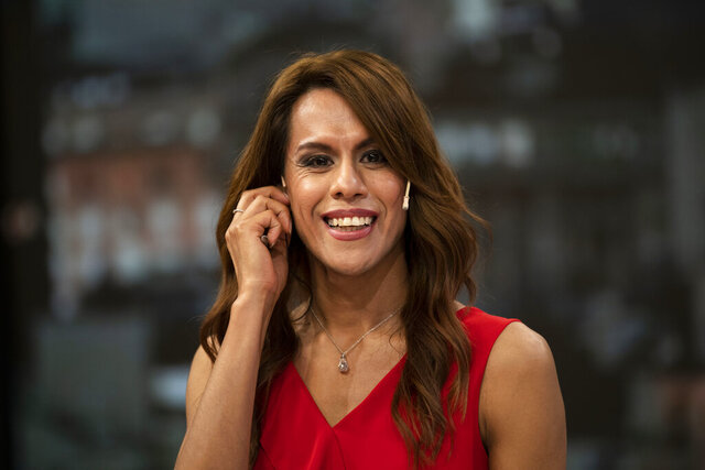 In this March 5, 2020 photo, Diana Zurco smiles during a rehearsal for her debut as the country's first transgender newscaster, in Buenos Aires, Argentina. Her job as a co-anchor of Public Television's prime time evening news program is a milestone for an excluded community that is often the target of violence and has a life expectancy roughly half that of the rest of the population. (AP Photo/Victor R. Caivano)