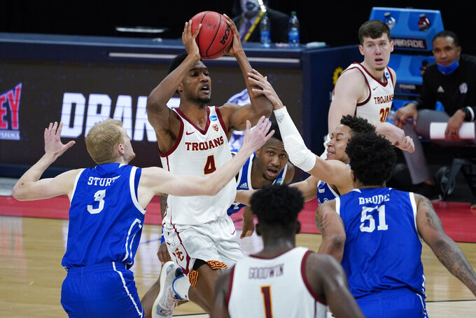 USC forward Evan Mobley (4) drives against Drake during the first half of a men's college basketball game in the first round of the NCAA tournament at Bankers Life Fieldhouse in Indianapolis, Saturday, March 20, 2021. (AP Photo/Paul Sancya)