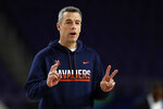 Virginia head coach Tony Bennett directs his team during a practice session for the semifinals of the Final Four NCAA college basketball tournament, Friday, April 5, 2019, in Minneapolis. (AP Photo/Jeff Roberson)