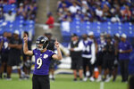 Baltimore Ravens kicker Justin Tucker reacts after booting a field goal during an NFL football training camp practice, Saturday, July 31, 2021, in Baltimore. (AP Photo/Gail Burton)