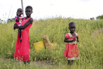In this photo taken Monday, Oct. 1, 2018, children stand in a field by the side of the road between Melut and in Paloch town, in South Sudan. The oil industry in South Sudan has left a landscape pocked with hundreds of open waste pits with the water and soil contaminated with toxic chemicals and heavy metals, and accounts of