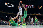 Memphis center James Wiseman, center, shoots over Oregon forward Shakur Juiston, right, and guard Chris Duarte, left, during the first half of an NCAA college basketball game in Portland, Ore., Tuesday, Nov. 12, 2019. (AP Photo/Craig Mitchelldyer)