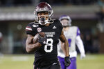 FILE - In this Nov. 23, 2019, file photo, Mississippi State running back Kylin Hill plays against Abilene Christian in an NCAA college football game in Starkville, Miss. Mississippi State's All-Southeastern Conference running back Kylin Hill recently took to Twitter to make his strong feelings known about the Mississippi state flag, which has the Confederate battle emblem in the top left corner. (AP Photo/Rogelio V. Solis, File)