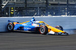 Scott Dixon, of New Zealand, spins in the fourth turn during practice for the Indianapolis 500 auto race at Indianapolis Motor Speedway in Indianapolis, Sunday, Aug. 16, 2020. (AP Photo/Kirk Stierwalt)