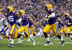 FILE - In this Saturday, Sept. 22, 2018, file photo, LSU linebacker Devin White (40) returns a fumble in the first half of an NCAA college football game against Louisiana Tech in Baton Rouge, La. No. 2 Georgia visits No. 13 LSU in a Southeastern Conference intersectional matchup that could impact each division race. (AP Photo/Tyler Kaufman, File)