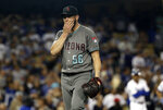 Arizona Diamondbacks relief pitcher Greg Holland walks off the mound after being pulled from the game after issuing a walk to load the bases during the ninth inning of a baseball game against the Los Angeles Dodgers on Tuesday, July 2, 2019, in Los Angeles. (AP Photo/Marcio Jose Sanchez)
