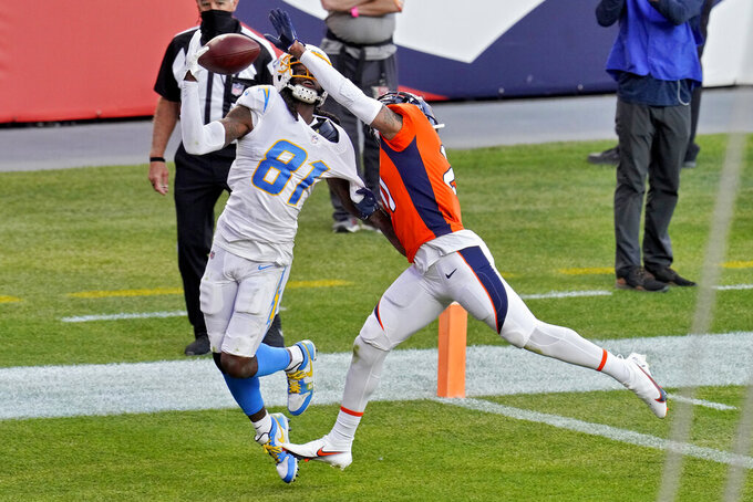 Los Angeles Chargers wide receiver Mike Williams (81) pulls in a touchdown pass as Denver Broncos cornerback A.J. Bouye defends during the first half of an NFL football game, Sunday, Nov. 1, 2020, in Denver. (AP Photo/Jack Dempsey)