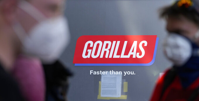 Workers block the entrance of a depot for German startup Gorillas, a grocery delivery company, during a protest against the firing of a colleague in Berlin, Germany, Thursday, June 10, 2021. The delivery service Gorillas now operates in dozens of cities across Germany, France, Italy, the Netherlands and Britain, and has already set its sights on New York. (AP Photo/Markus Schreiber)