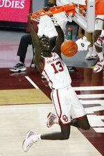 Oklahoma's Anyang Garang dunks during the second half of the team's NCAA college basketball game against Florida A&M in Norman, Okla., Saturday, Dec. 12, 2020. (AP Photo/Garett Fisbeck)