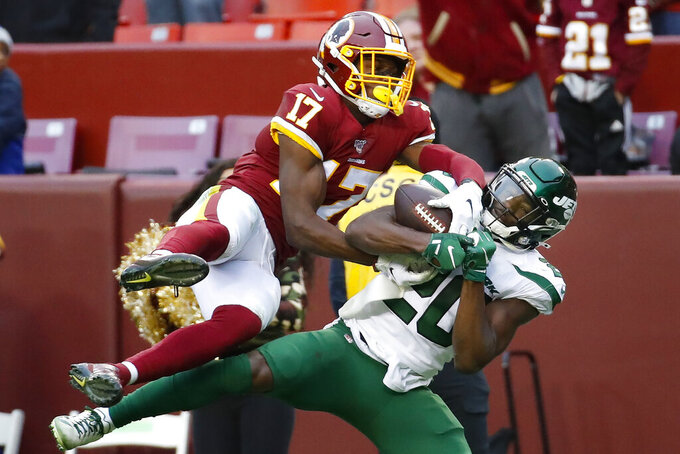Washington Redskins wide receiver Terry McLaurin (17) beats out New York Jets free safety Marcus Maye (20) to make the catch during the second half of an NFL football game, Sunday, Nov. 17, 2019, in Landover, Md. New York Jets won the game 34-17. (AP Photo/Alex Brandon)