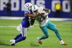 Indianapolis Colts safety Khari Willis (37) tackles Miami Dolphins running back Kalen Ballage (27) during the second half of an NFL football game in Indianapolis, Sunday, Nov. 10, 2019. (AP Photo/Darron Cummings)