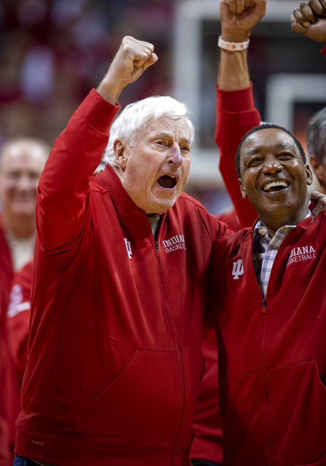 Former Indiana basketball head coach Bobby Knight, left, yells