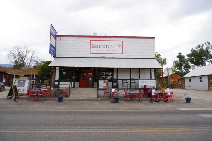 This Wednesday, June 23, 2021 photo shows  Kerouac's bar and restaurant in rural Baker, Nev. along the Utah line. The eatery is owned by a couple that gave up urban life in New York City back in 2017 to move to the remote area near Great Basin National Park. (Ed Komenda/The Reno Gazette-Journal via AP)