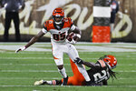 Cincinnati Bengals wide receiver Tee Higgins (85) breaks a tackle from Cleveland Browns cornerback Tavierre Thomas (20) during the second half of an NFL football game Thursday, Sept. 17, 2020, in Cleveland. (AP Photo/Ron Schwane)