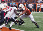 FILE - In this Nov. 29, 2019, file photo, Texas lineman Sam Cosmi, right, blocks against Texas Tech's Tony Bradford, left, during an NCAA college football game in Austin, Texas. The Washington Football Team selected Cosmi on Friday, April 30, 2021, with the 51st pick in the draft. (AP Photo/Michael Thomas, File)