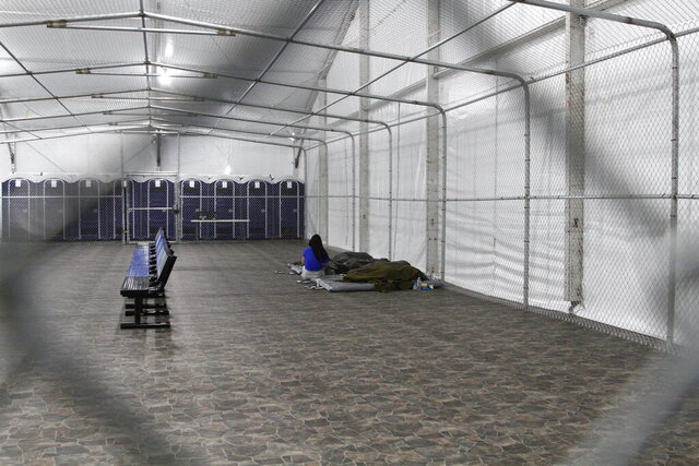 FILE - in this Aug. 15, 2019, file photo, migrants are detained in a tented, air-conditioned cage at a Border Patrol detention facility in Tornillo, Texas. A Border Patrol detention facility in West Texas could be a case study in wasting congressional funds money according to a report released this week by a congressional watchdog. In a period of five months, Customs and Border Protection paid around $5 million for food that was never ordered, about 650,000 unneeded meals, according to the Government Accountability Office report released Thursday, April 9, 2020. (AP Photo/Cedar Attanasio File)