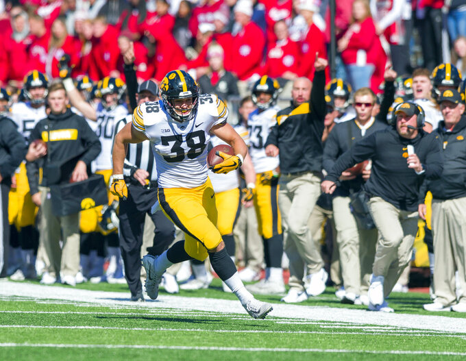 Iowa tight end T.J. Hockenson (38) rushes the ball up the sideline and into the end zone to score during the second half of an NCAA college football game against Indiana, Saturday, Oct. 13, 2018, in Bloomington, Ind. Iowa won 42-16. (AP Photo/Doug McSchooler)