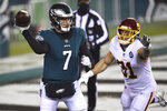 Philadelphia Eagles' Nate Sudfeld (7) passes against Washington Football Team's Ryan Kerrigan (91) during the second half of an NFL football game, Sunday, Jan. 3, 2021, in Philadelphia. (AP Photo/Derik Hamilton)