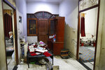 In this Tuesday, Dec. 24, 2019, photo, Anwar Ilahi, 74, sits next to a vandalized room of his house allegedly by the police after protests against Citizenship Amendment Act, in Muzaffarnagar, India. Tens of thousands of people have taken to the streets to oppose a new law that grants a path to citizenship for immigrants of every religion except Islam. Many say the law, passed by Prime Minister Narendra Modi's Hindu-nationalist government, discriminates against Muslims and undermines the country's secular foundations. (AP Photo/Rajesh Kumar Singh)