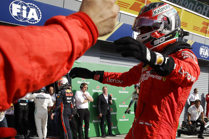 Ferrari driver Charles Leclerc of Monaco celebrates with his team after winning the Formula One Italy Grand Prix at the Monza racetrack, in Monza, Italy, Sunday, Sept. 8, 2019. (AP Photo/Luca Bruno)