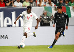 Canada midfielder Alphonso Davies, left, drives past Mexico defender Edson Alvarez during the first half of a CONCACAF Gold Cup soccer match Wednesday, June 19, 2019, at Mile High Stadium in Denver. (AP Photo/David Zalubowski)