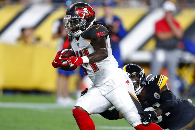 Tampa Bay Buccaneers running back Dare Ogunbowale (44) gets past Pittsburgh Steelers cornerback Justin Layne (31) for a touchdown during the second half of an NFL football game in Pittsburgh, Friday, Aug. 9, 2019. (AP Photo/Keith Srakocic)