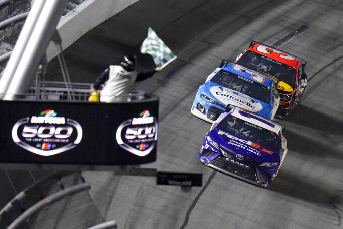 Denny Hamlin wins the first stage during the NASCAR Daytona 500 auto race at Daytona International Speedway, Sunday, Feb. 14, 2021, in Daytona Beach, Fla. (AP Photo/Chris O'Meara)