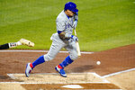 Chicago Cubs' Javier Baez drives in a run from third with a bunt single off Pittsburgh Pirates starting pitcher JT Brubaker during the second inning of a baseball game in Pittsburgh, Monday, Sept. 21, 2020. (AP Photo/Gene J. Puskar)