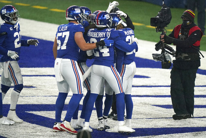 New York Giants' Xavier McKinney, right, celebrates his interception in the end zone during the second half of an NFL football game against the Dallas Cowboys, Sunday, Jan. 3, 2021, in East Rutherford, N.J. (AP Photo/Corey Sipkin)