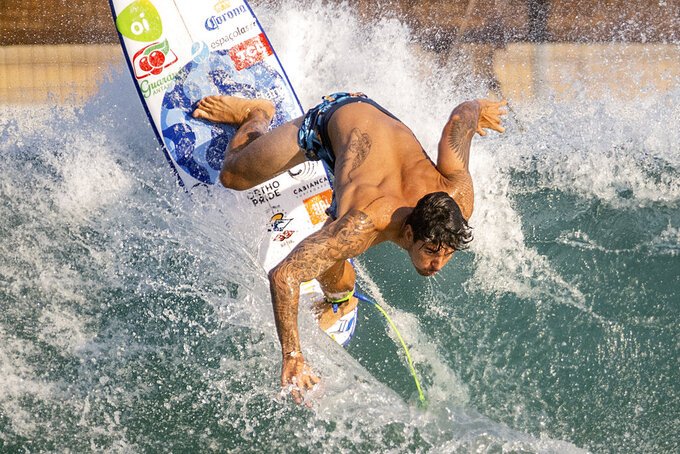 Surfer Gabriel Medina of Brazil works out on a Surf Ranch wave during practice rounds for the upcoming Olympics Wednesday, June 16, 2021, in Lemoore, Calif. This year, Medina and fellow Brazilian Italo Ferreira are expected to rule the men's competition at surfing's long-awaited debut as an Olympic sport in the Tokyo 2020 Games. While the surfing community has long pledged that the ocean is for everyone, a look at the professional ranks show a sport that remains expensive and inaccessible. A series of recent industry efforts to help groom the next generation outside of the usual hot spots of Hawaii, California and Australia look to be a tacit acknowledgement of the existing disparities among its talent bench. (AP Photo/Noah Berger)