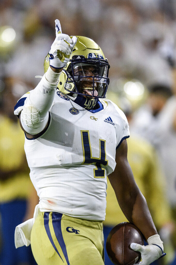 Georgia Tech linebacker Quez Jackson celebrates a fumble recovery during the second half of the team's NCAA college football game against Northern Illinois on Saturday, Sept. 4, 2021, in Atlanta. (AP Photo/Danny Karnik)