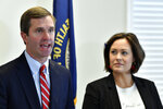 Kentucky Governor-Elect Andy Beshear, left, and his Lt. Governor Jacqueline Coleman speak with reporters following the concession of incumbent Governor Matt Bevin in Frankfort, Ky., Thursday, Nov. 14, 2019. In a recanvass, Beshear defeated Bevin by 5136 votes. (AP Photo/Timothy D. Easley)