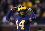 Michigan defensive back Josh Metellus (14) celebrates a play in the second half of an NCAA college football game against Indiana in Ann Arbor, Mich., Saturday, Nov. 17, 2018. (AP Photo/Paul Sancya)