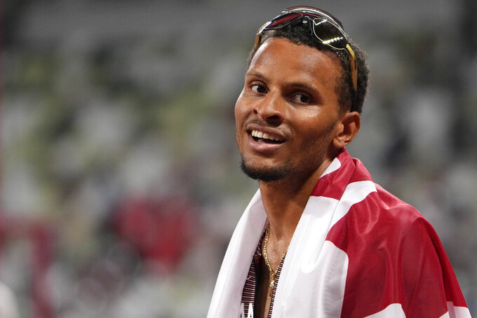 Andre De Grasse, of Canada, celebrates after winning the final of the men's 200-meters at the 2020 Summer Olympics, Wednesday, Aug. 4, 2021, in Tokyo, Japan. (AP Photo/Markus Schreiber)