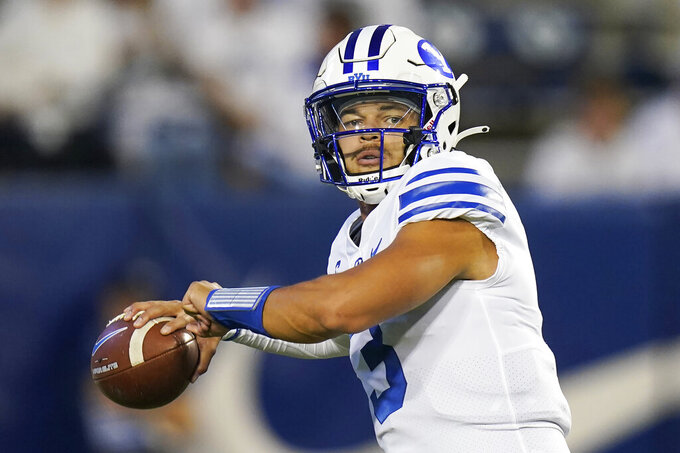 BYU quarterback Jaren Hall warms up for the team's NCAA college football game against Arizona State on Saturday, Sept. 18, 2021, in Provo, Utah. (AP Photo/Rick Bowmer)