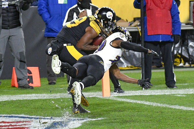 Pittsburgh Steelers wide receiver JuJu Smith-Schuster (19) makes a touchdown catch as Baltimore Ravens cornerback Tramon Williams defends during the second half of an NFL football game Wednesday, Dec. 2, 2020, in Pittsburgh. (AP Photo/Don Wright)