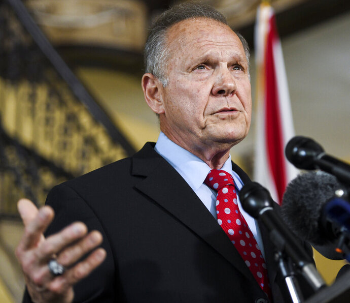 In this June 20, 2019, photo, former Alabama Chief Justice Roy Moore announces his run for the republican nomination for U.S. Senate in Montgomery, Ala. Moore has raised less than $17,000 for his U.S. Senate race, according to quarterly campaign reports filed this week. (AP Photo/Julie Bennett)