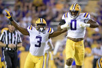 LSU defensive lineman Maason Smith (0) and defensive end Andre Anthony (3) celebrate a sack of McNeese State quarterback Cody Orgeron during the first half of aan NCAA college football game in Baton Rouge, La., Saturday, Sept. 11, 2021. (AP Photo/Matthew Hinton)