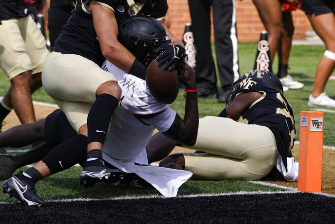 Louisville quarterback Malik Cunningham scores against Wake Forest during the first half of an NCAA college football game on Saturday, Oct. 2, 2021, in Winston-Salem, N.C. (AP Photo/Chris Carlson)