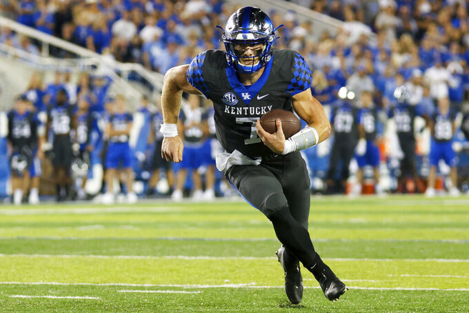 Kentucky quarterback Will Levis runs the ball into the end zone for a touchdown during the second half of the team's NCAA college football game against LSU in Lexington, Ky., Saturday, Oct. 9, 2021. (AP Photo/Michael Clubb)