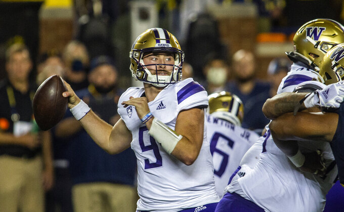 Washington quarterback Dylan Morris (9) throws a pass in the second quarter of an NCAA college football game against Michigan in Ann Arbor, Mich., Saturday, Sept. 11, 2021. (AP Photo/Tony Ding)